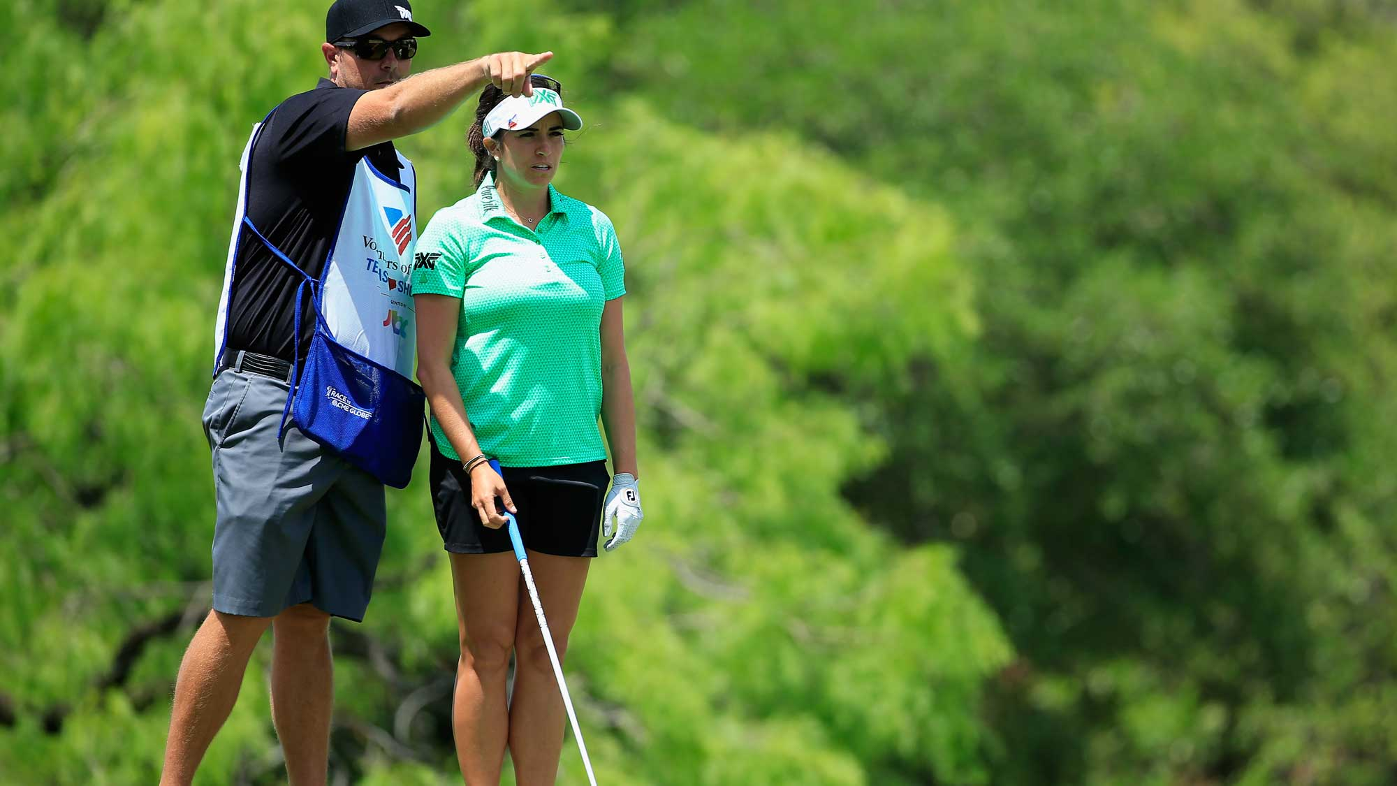 Gerina Piller lines up her tee shot on the third hole with her caddie Brian Dilley during the third round of the Volunteers of America Texas Shootout