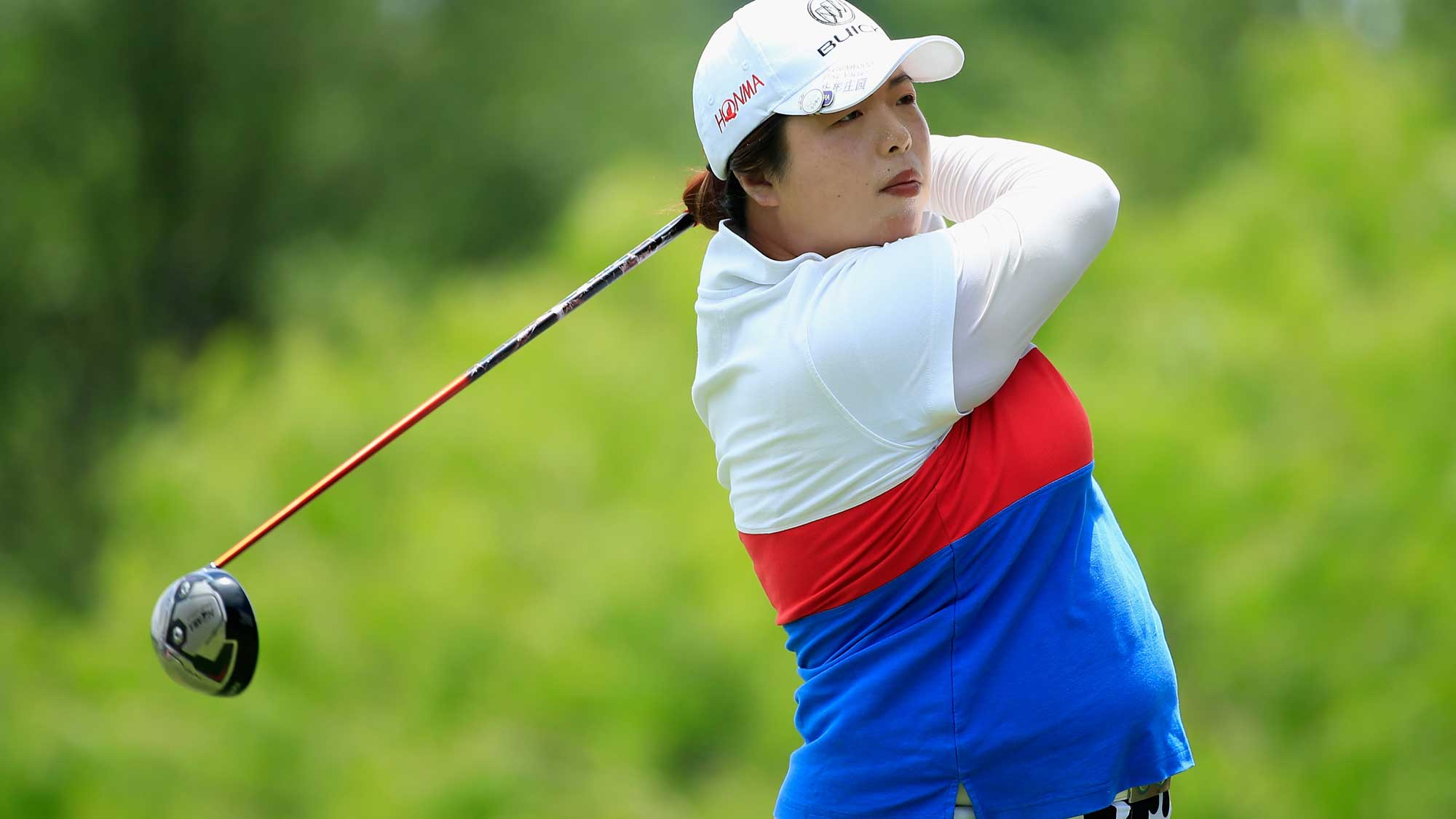 Shanshan Feng of China hits her tee shot on the eighth hole during the third round of the Volunteers of America Texas Shootout