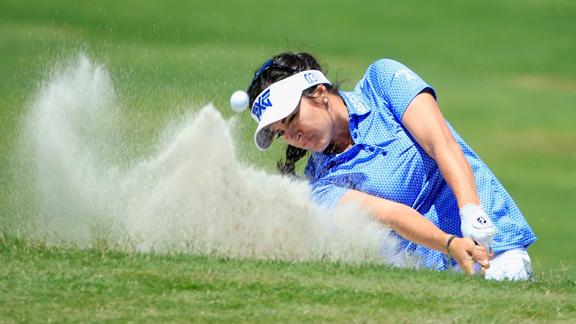 Gerina Piller plays a bunker shot on the third hole during the final round of the Volunteers of America Texas Shootout