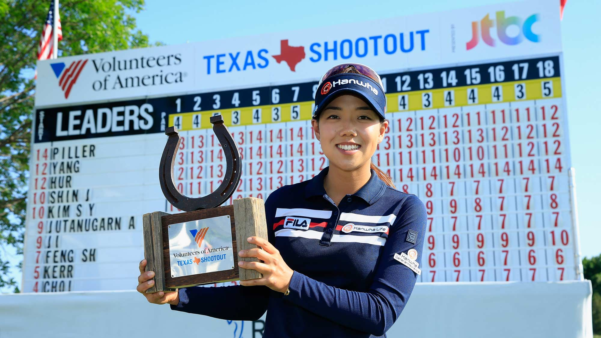 Jenny Shin poses with the trophy after her two-stroke victory at the Volunteers of America Texas Shootout