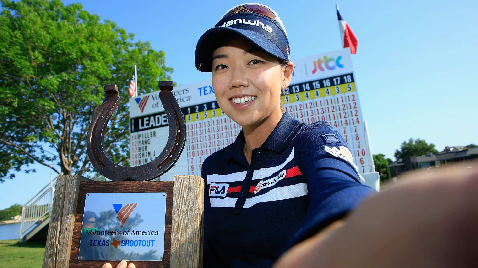 Jenny Shin poses for a simulated 'Selfie' with the trophy after her two-stroke victory at the Volunteers of America Texas Shootout
