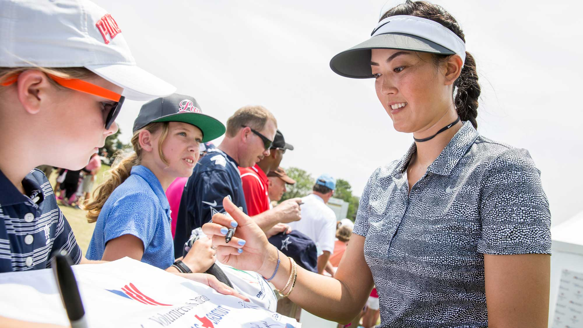 Michelle Wie of the United States signs autographs following the second round of the Volunteers of America Texas Shootout