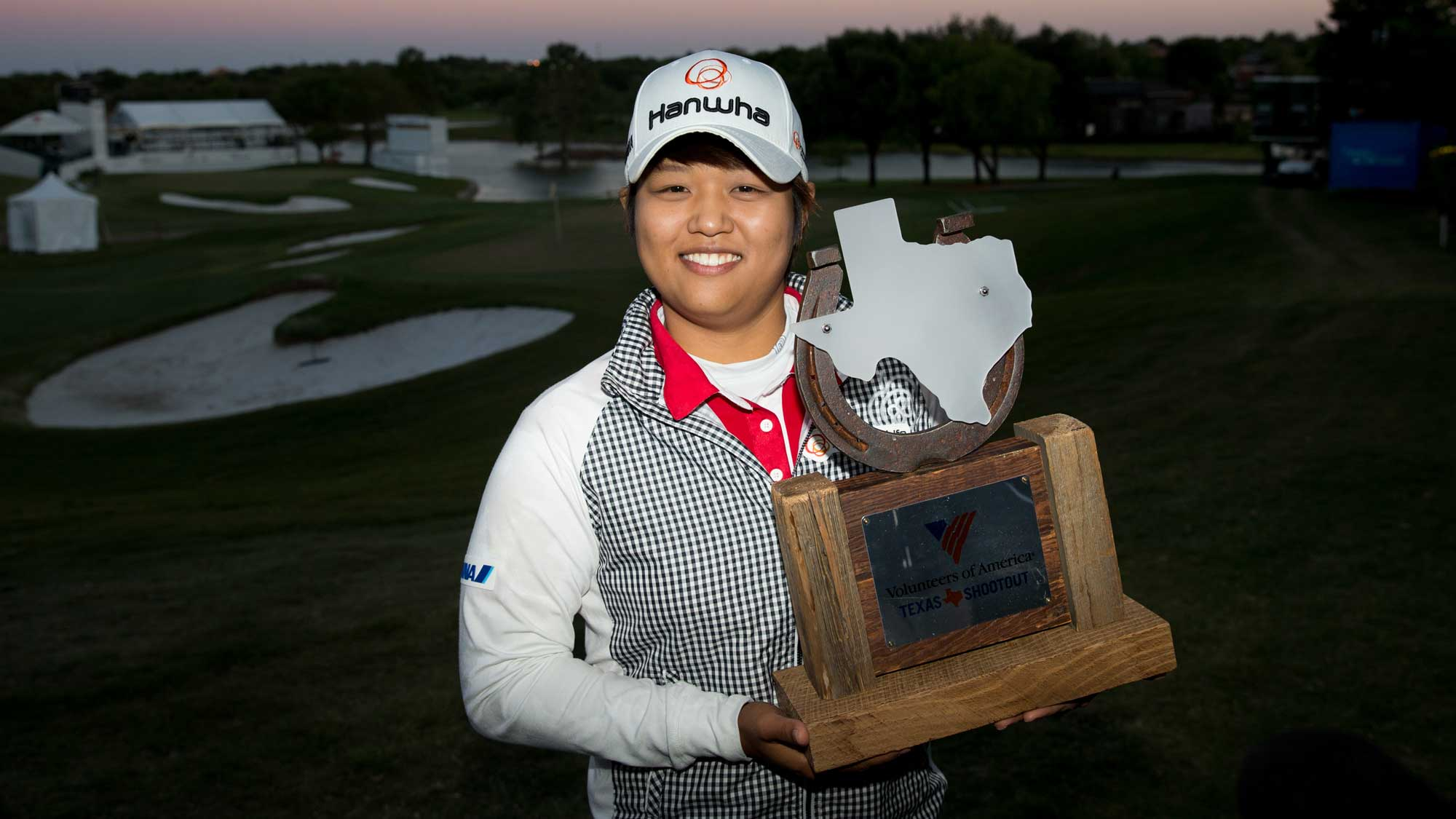 Haru Nomura of Japan poses with the champion's trophy following her playoff victory over Cristie Kerr in the final round of the Volunteers of America Texas Shootout