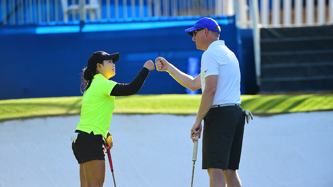 Moriya Jutanugarn celebrates with a member of her Wednesday Pro-Am Team at the 2016 Walmart NW Arkansas Championship