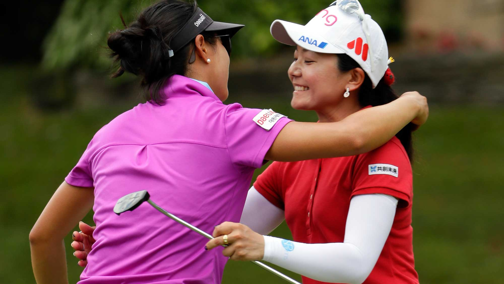 Ayako Uehara of Japan hugs Kelly W Shon on the 9th hole after their round during the first round of the Walmart NW Arkansas Championship