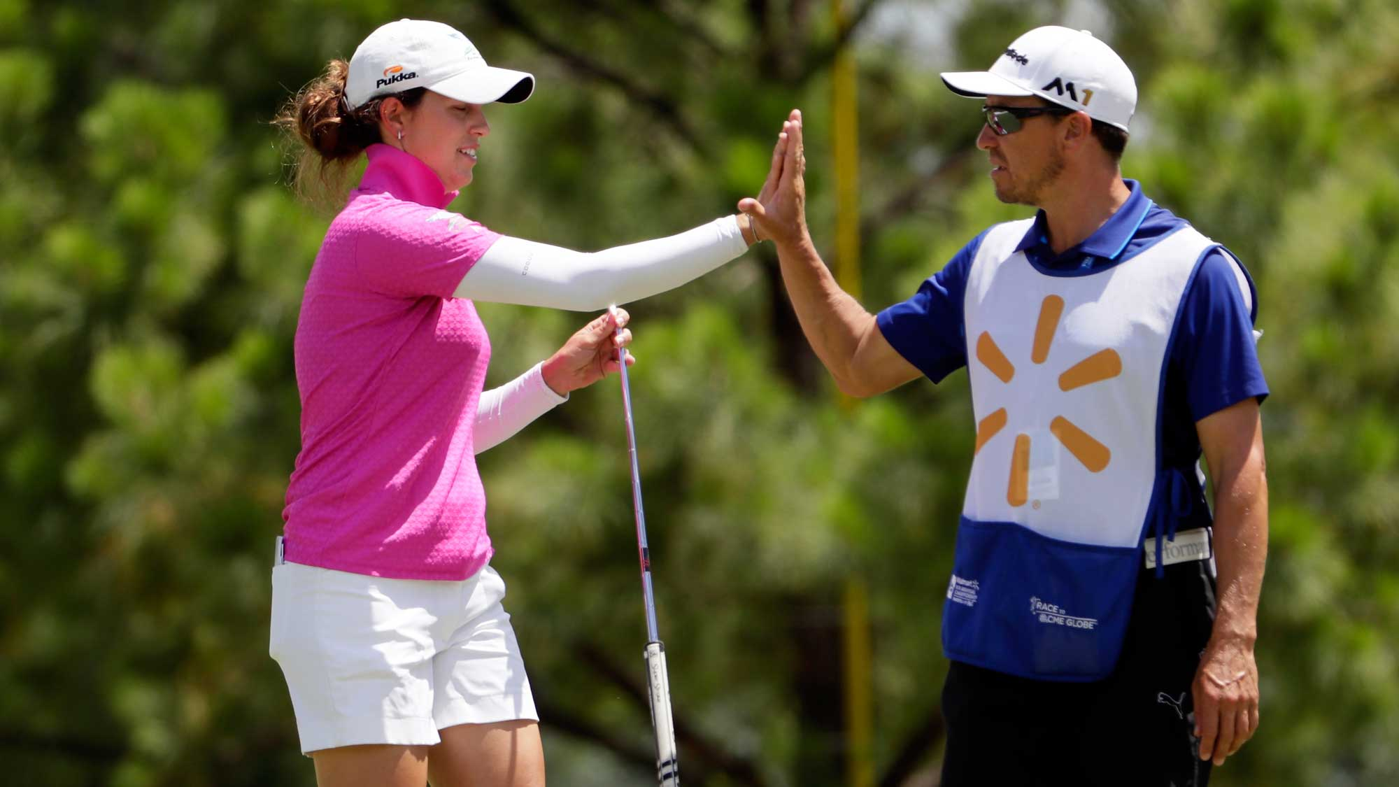 Giulia Molinaro of Italy high-fives her caddie after making a putt on the 1st hole during the final round of the Walmart NW Arkansas Championship