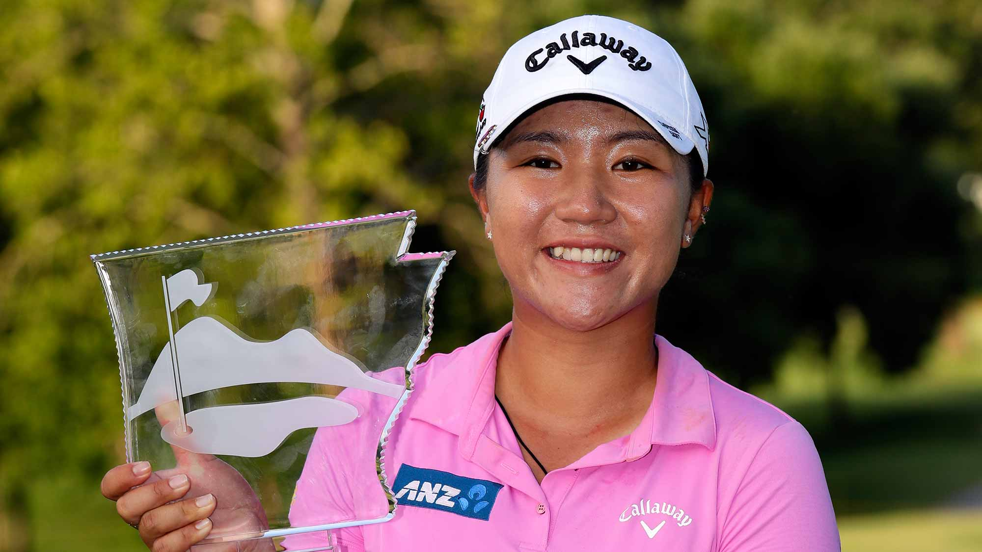 Lydia Ko of New Zealand displays the trophy after winning the Walmart NW Arkansas Championship