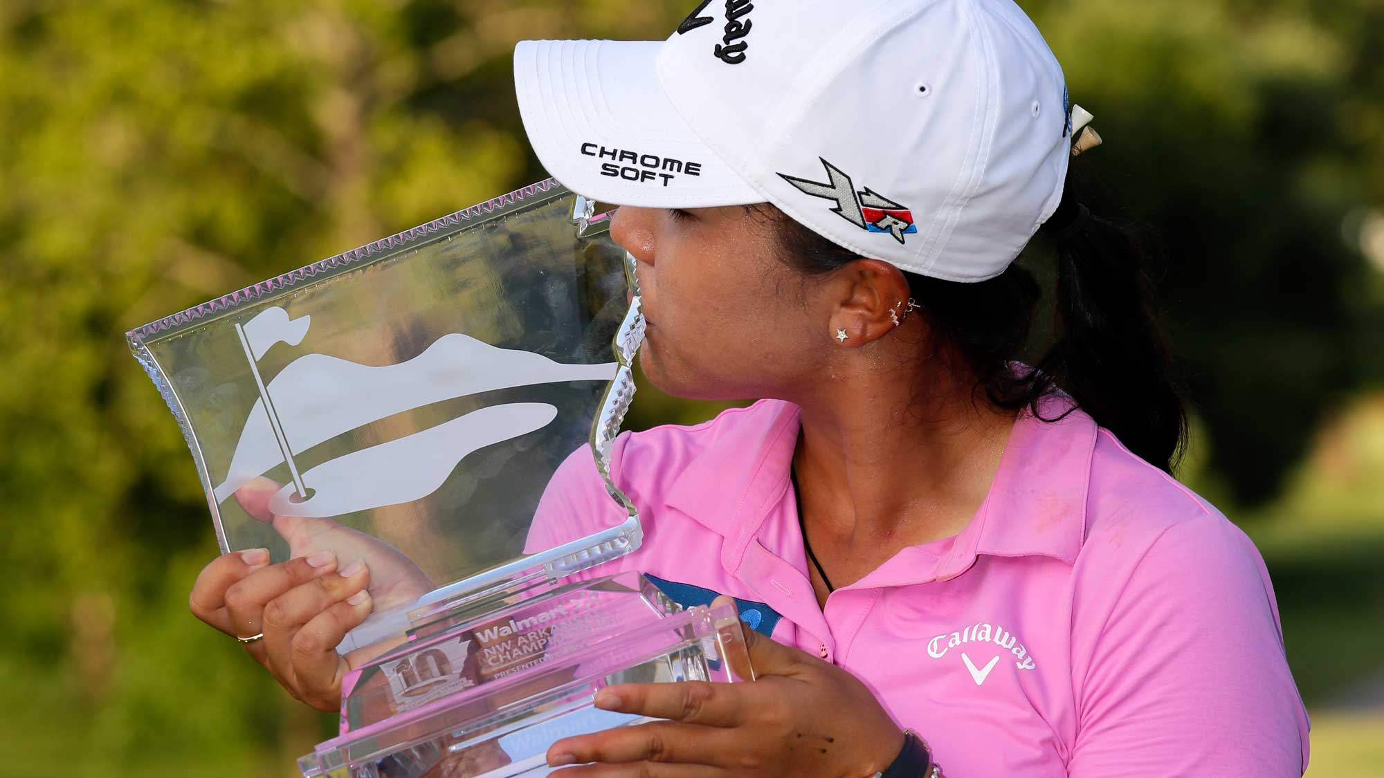 Lydia Ko of New Zealand kisses the trophy after winning the Walmart NW Arkansas Championship