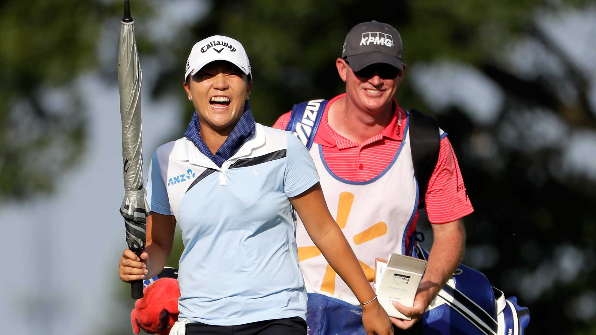 Lydia Ko of New Zealand jokes while she walks up the fairway on the 18th hole during the second round of the Walmart NW Arkansas Championship